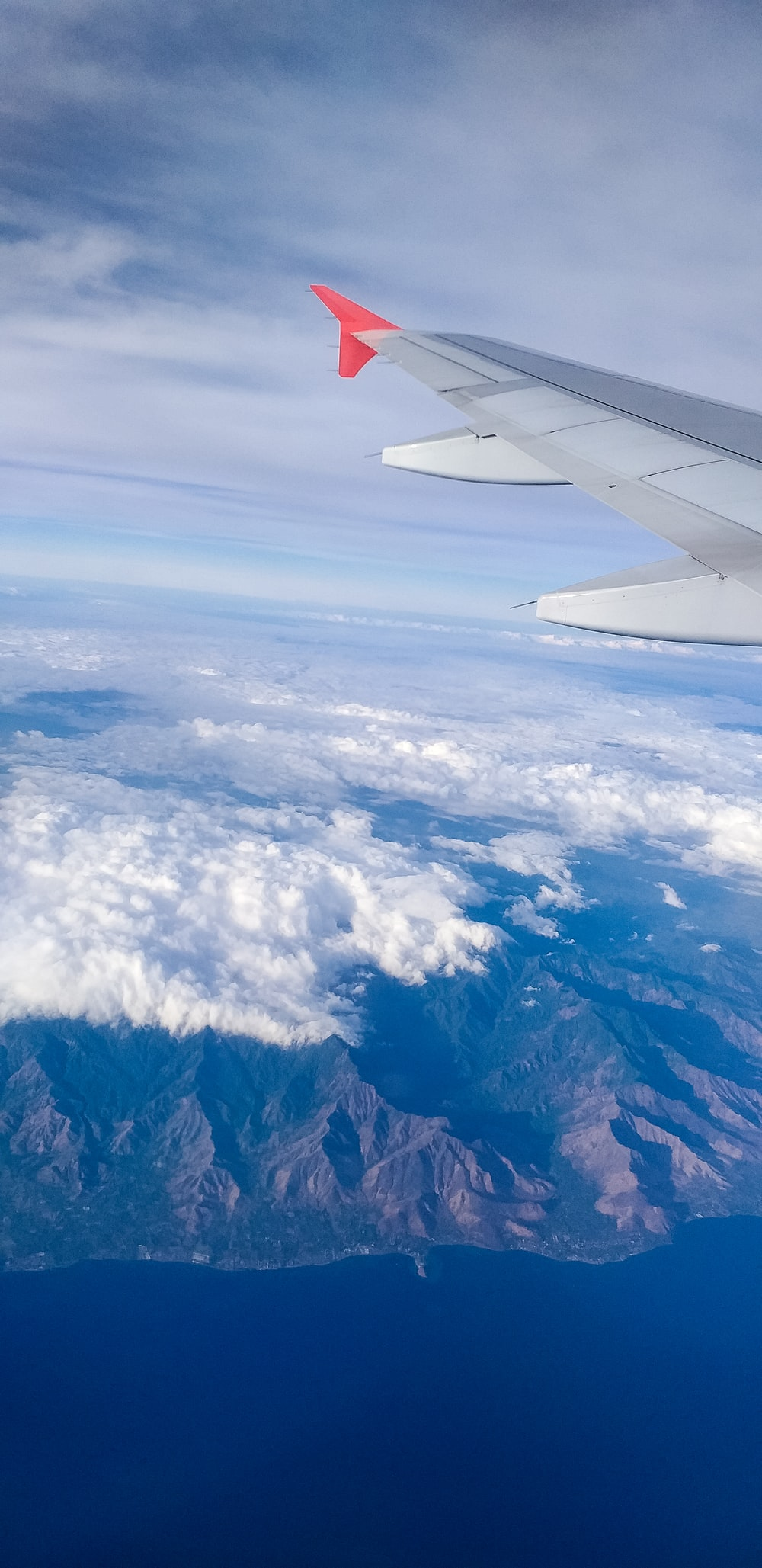 plane over mountains and cloud