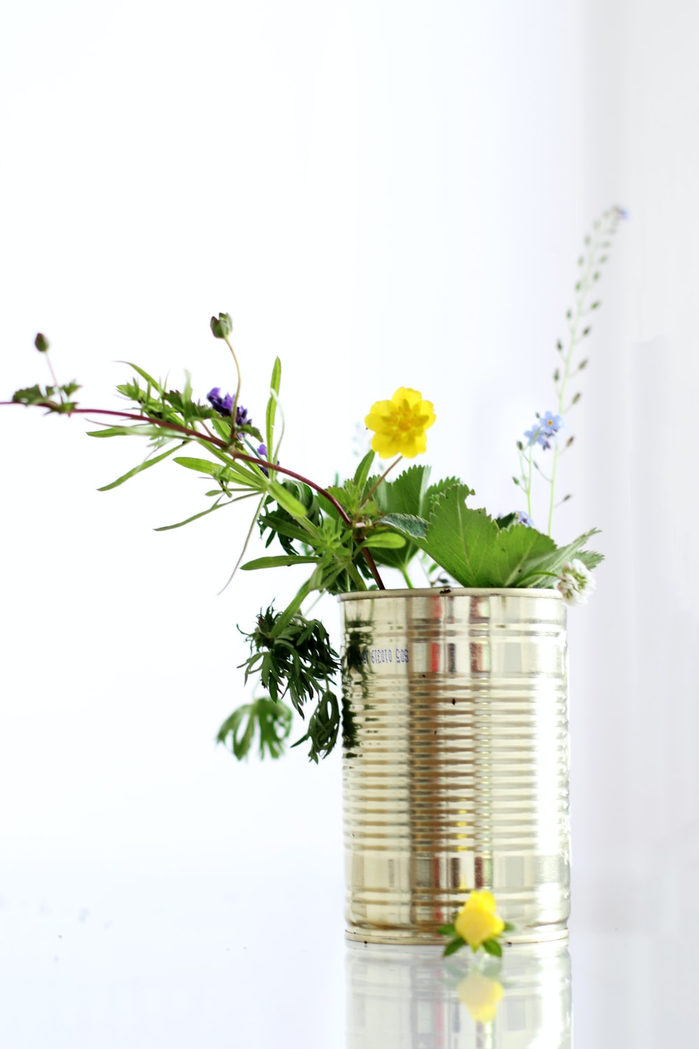 yellow petaled flower in the stainless steel can