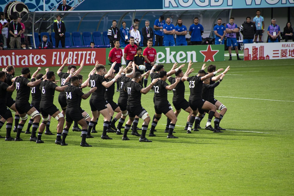 rugby team dancing in the field