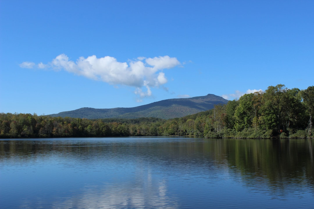 Julian Price Lake with Grandfather Mountain in the background.  A very beautiful, peaceful and serene place to stop, rest, and relax.  It is one of my all-time favorite places to just come and sit by while watching the clouds drift by me.