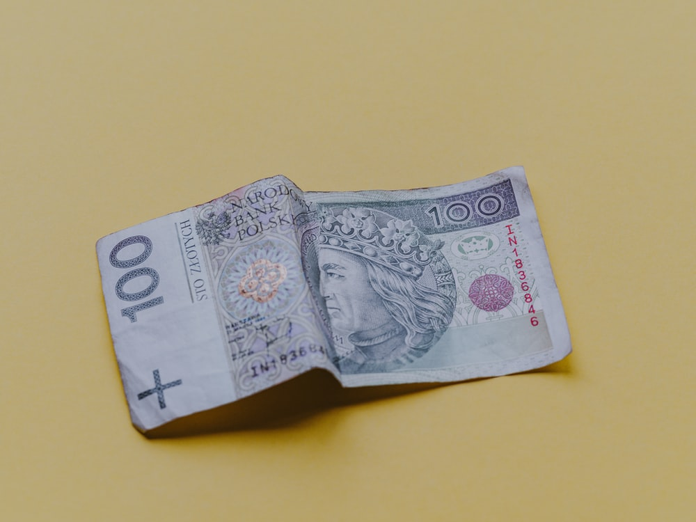 100 banknote on beige cloth