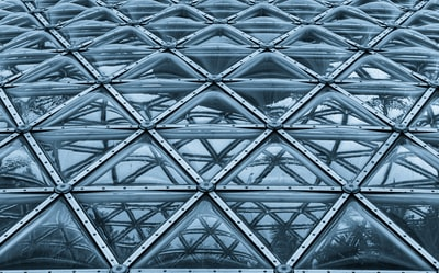 macro photography of glass walled building