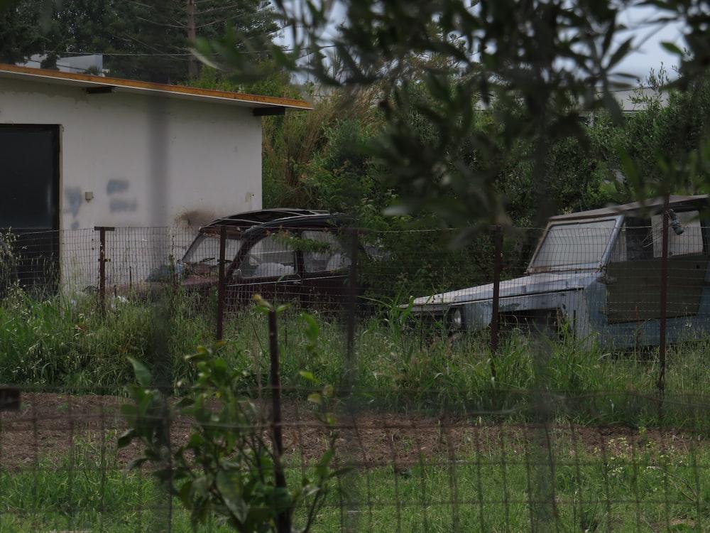 grey vehicle near the house