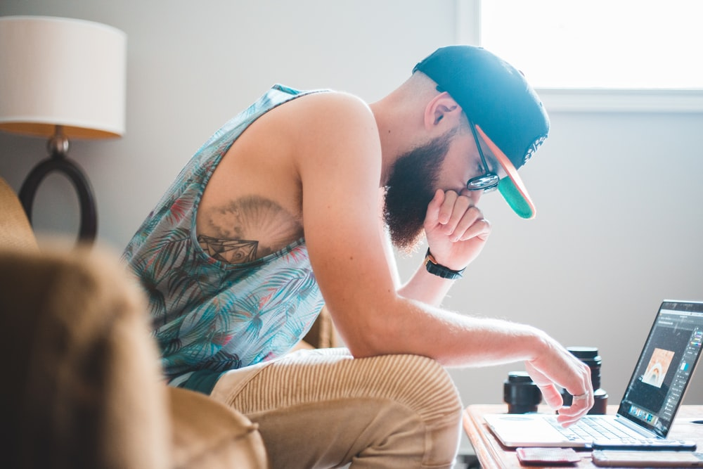 man sitting in front of laptop computer