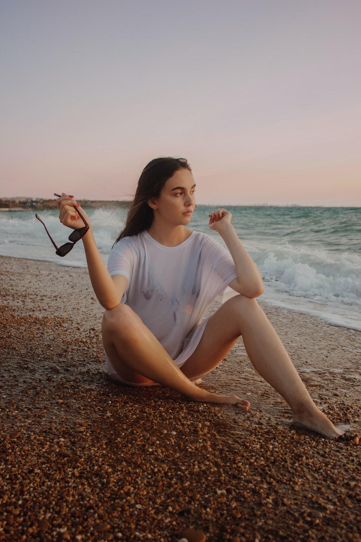woman sitting on the seashore