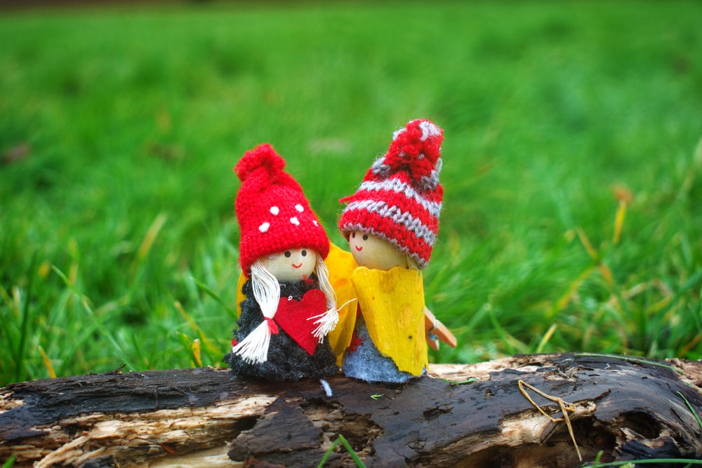 two doll wearing knit caps