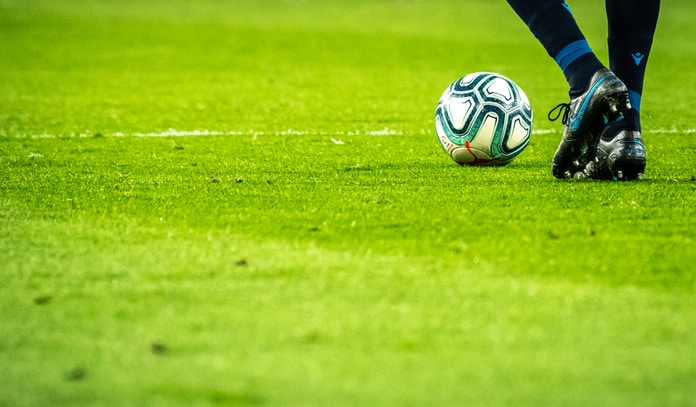 man playing soccer game on field