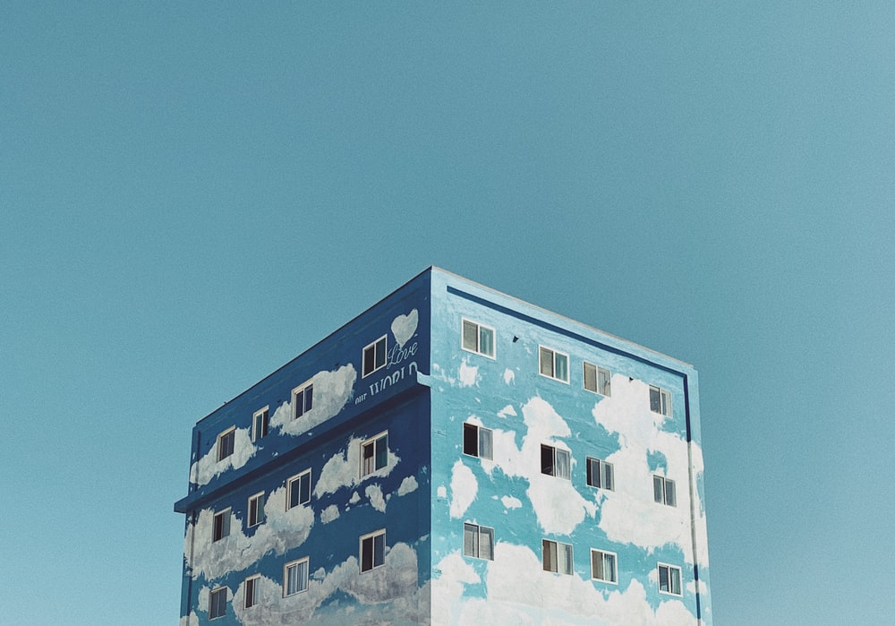 landscape photography of blue and white cloud painted building