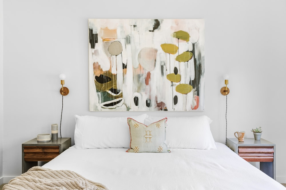 white and brown bed sheet