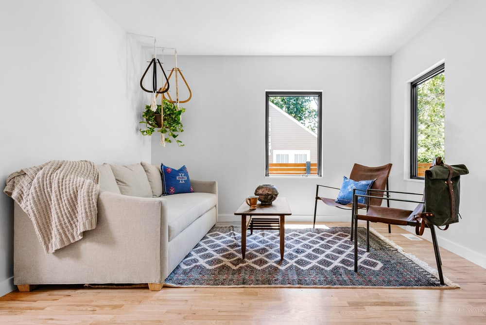 Enjoyable Photo Of Gray Couch In Front Of Brown Wooden Table Photo Alphanode Cool Chair Designs And Ideas Alphanodeonline