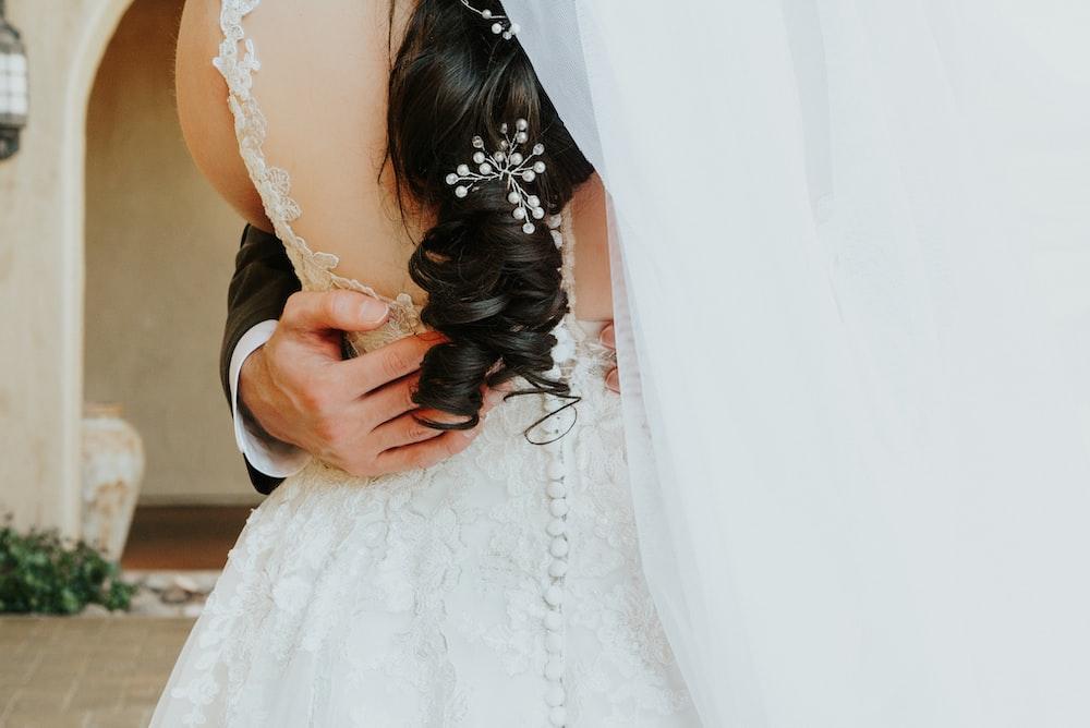 woman wearing white wedding gown
