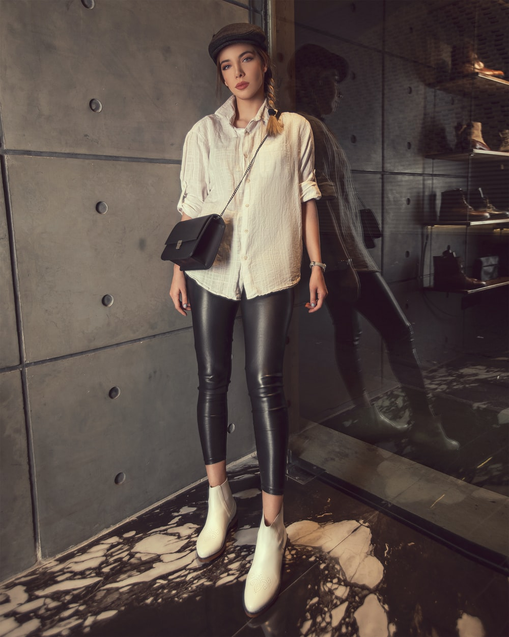 woman wearing white dress shirt and black leather leggings