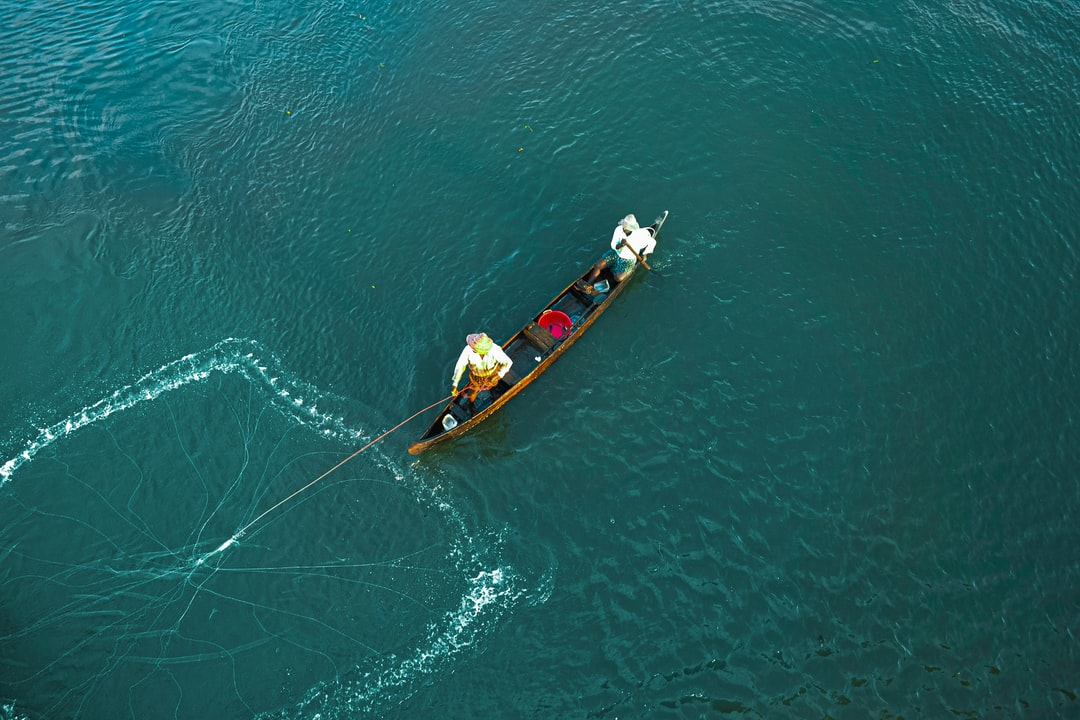 Fisherman casting net throw