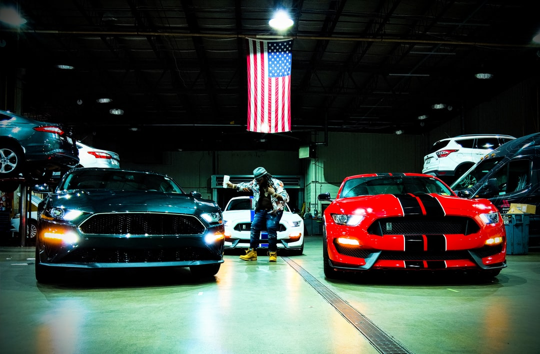 "We did photography for a music video. This was taken inside the garage of a local Ford Dealership. The lighting was both challenging and rewarding.  Red, green, and white Mustangs. African American Male. American flag. ""Not if you measure life by how one lives.."" - Nas"