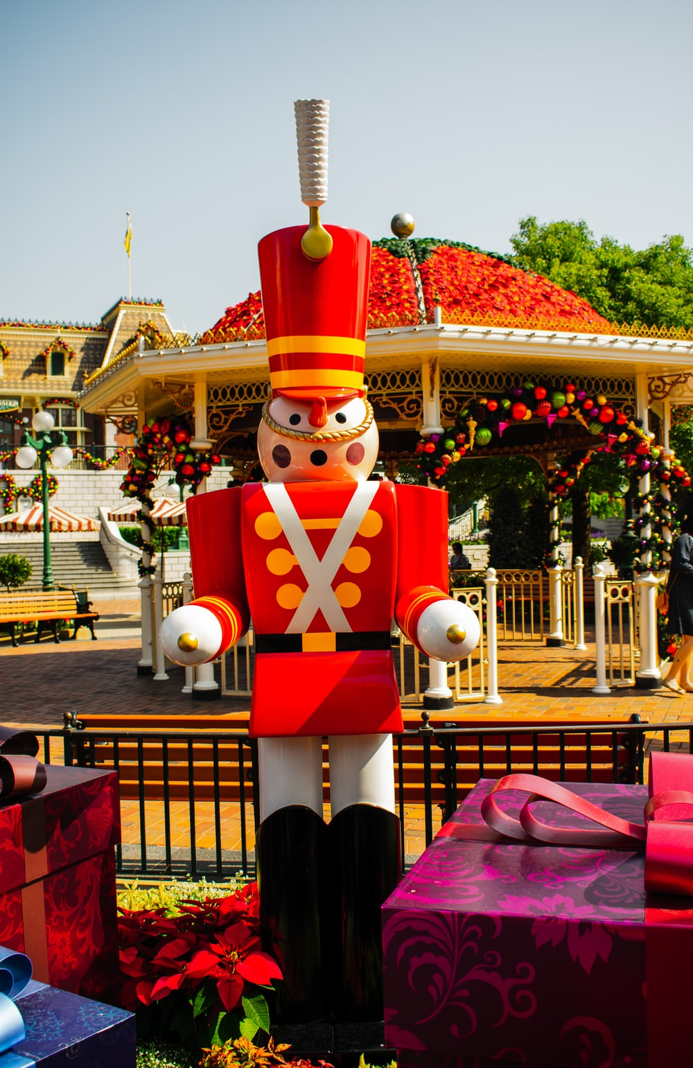 nutcracker statue in between of gift boxes