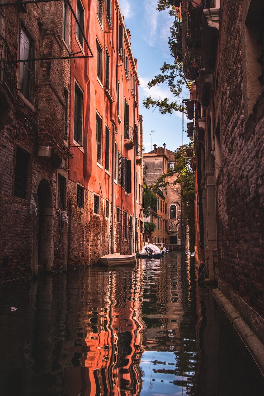 calm body of water in between of buildings