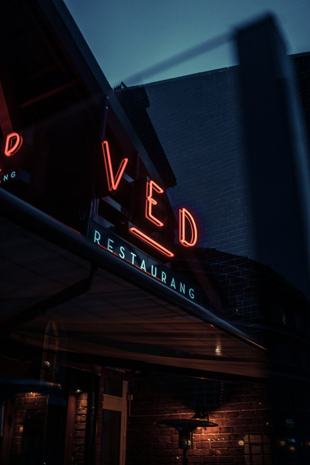 Ved signage at night