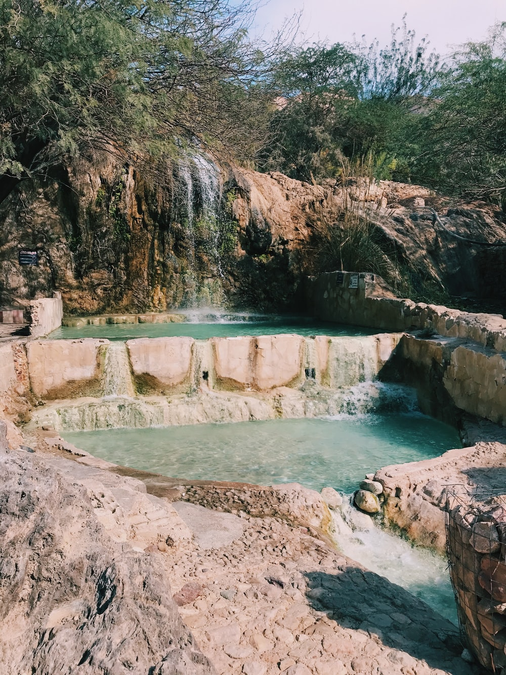 view photography of pond and waterfalls