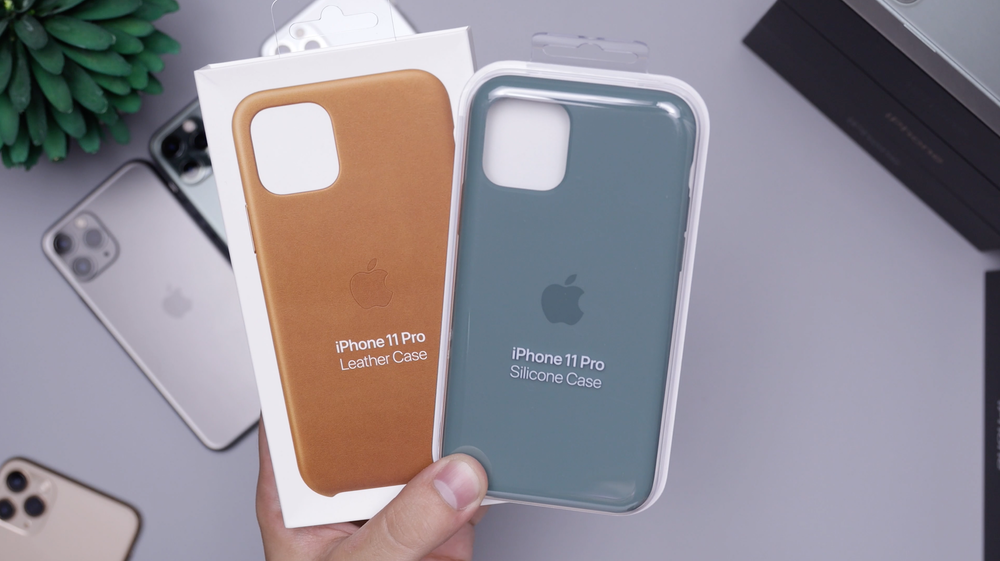 two blue and brown iPhone cases