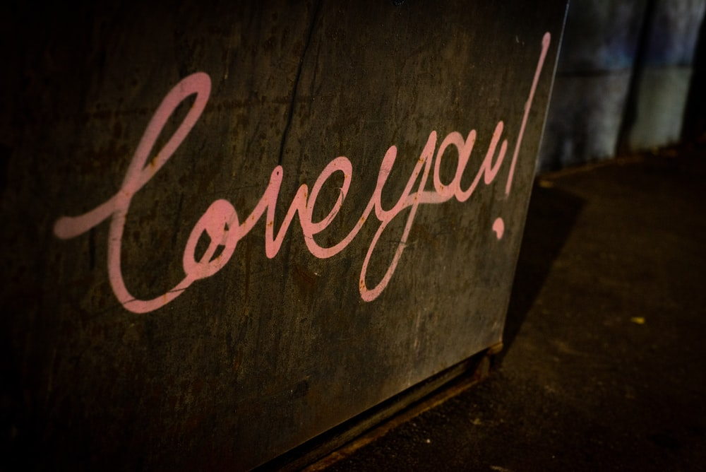 loveyou! text on brown wall