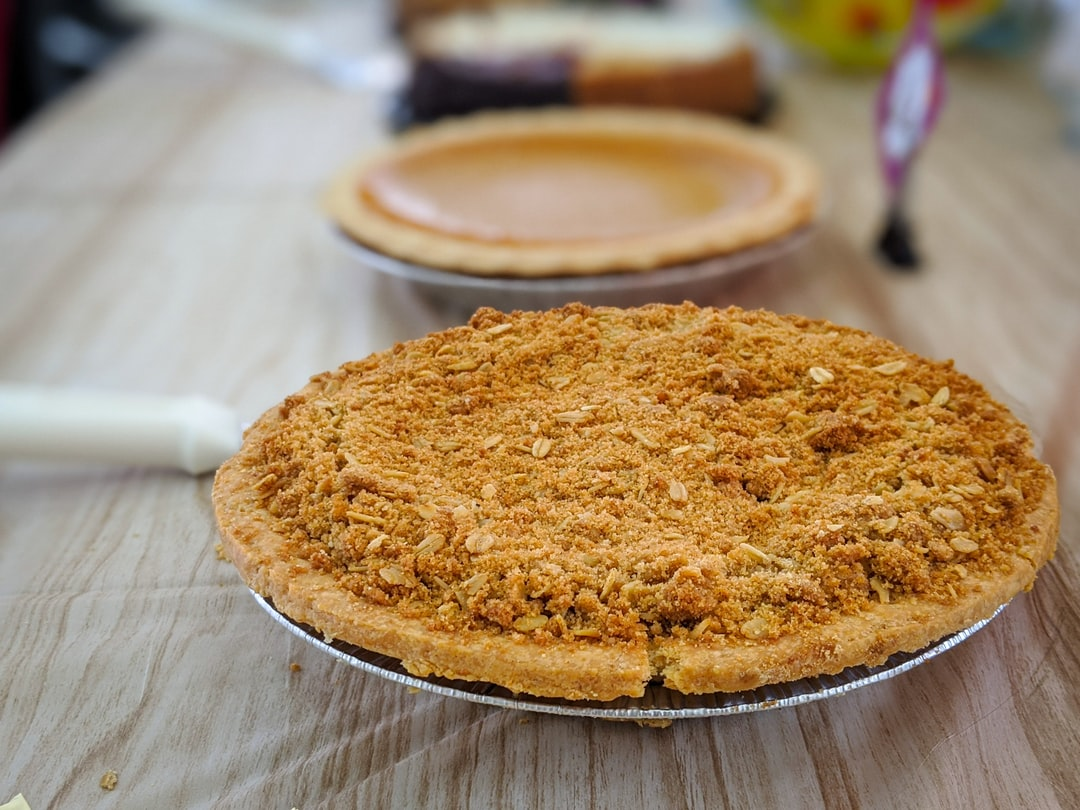 """Pies on a wooden table. """"He can get his own portion of cornbread."""" - Eddie Murphy"""