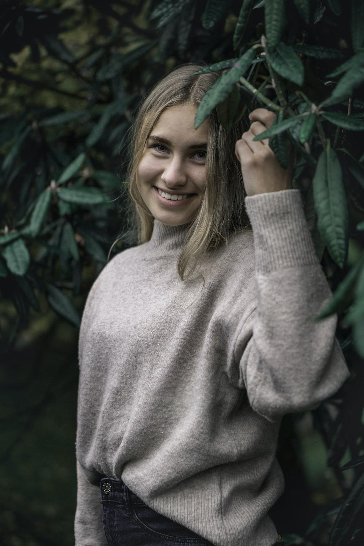 woman standing near green leaf plant
