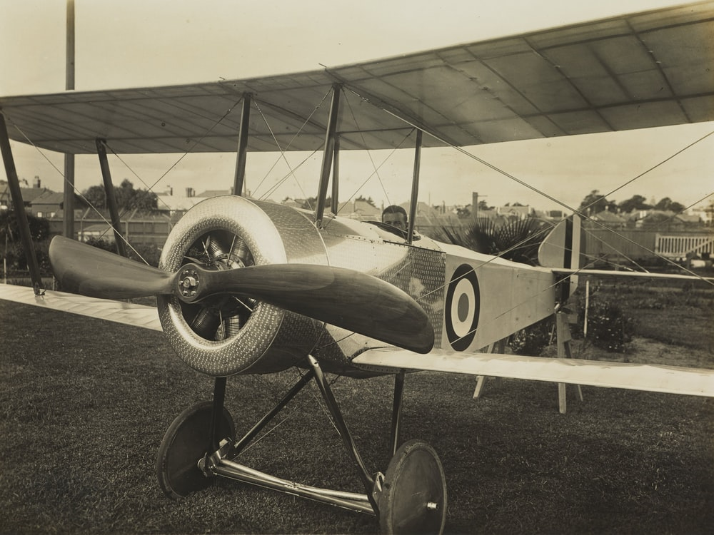 grayscale photography of biplane