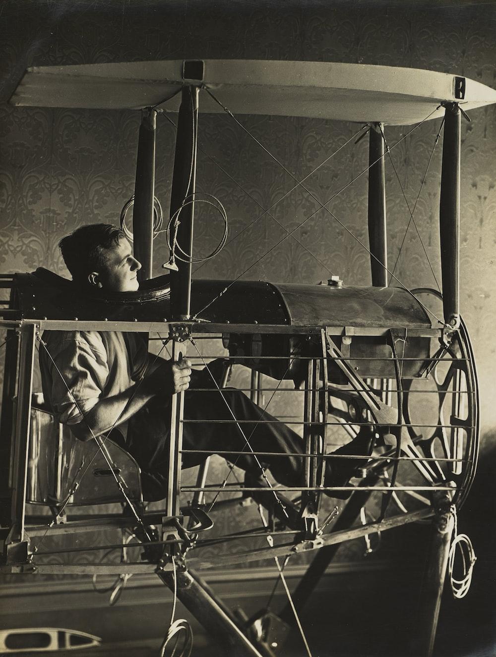 man in plane frame