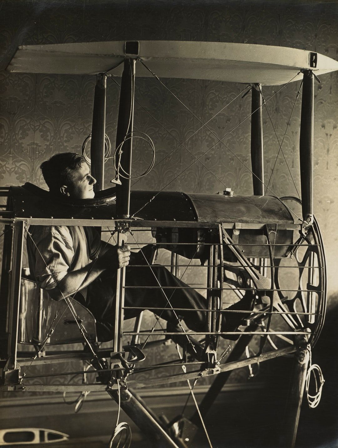 Basil Watson Seated in Cockpit of Partially Constructed Biplane Fuselage in the Family Home, Elsternwick, Victoria, 1916