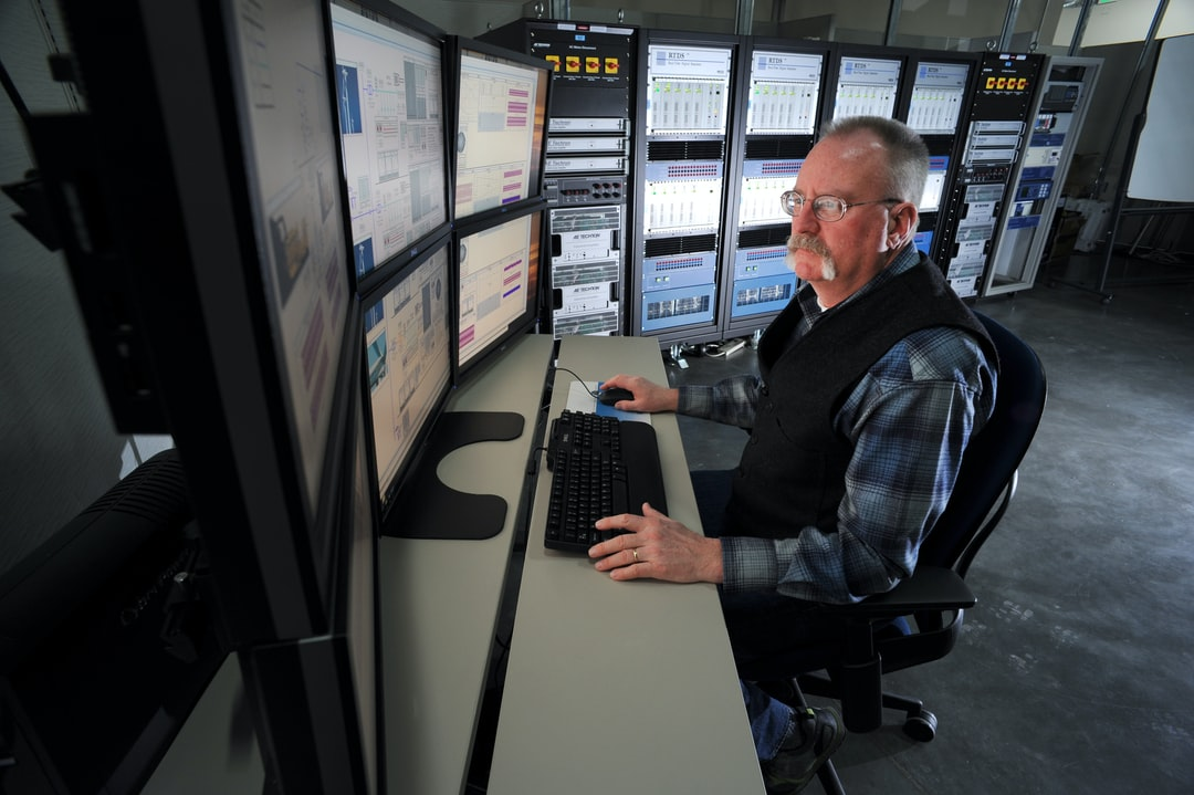 An Idaho National Laboratory power grid researcher uses one of the laboratory's Real Time Digital Simulators to model the effects of a power disruption.