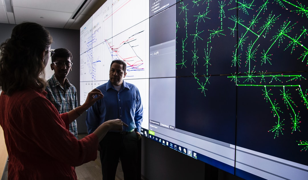 NREL engineers work with an Advanced Distributed management Systems (ADMS) Test bed, a multi-timescale simulation environment that will take advantage of the controller and power hardware in the loop capabilities at the Energy Systems Integration Facility (ESIF) to evaluate real time distribution systems to solve complex grid control challenges, reduce costs, and improve reliability.