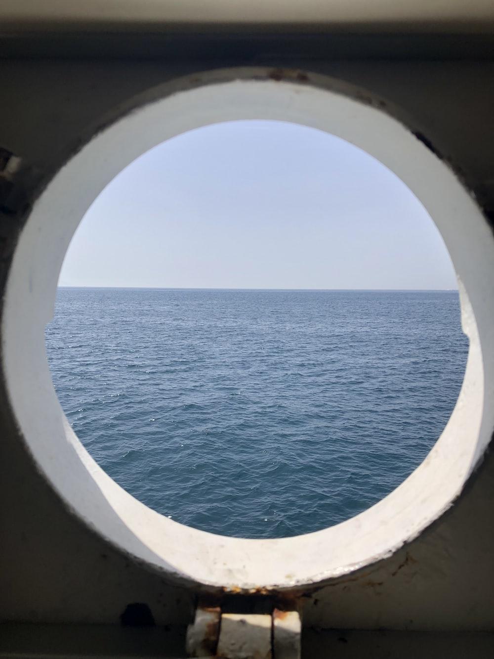 window showing sea during daytime