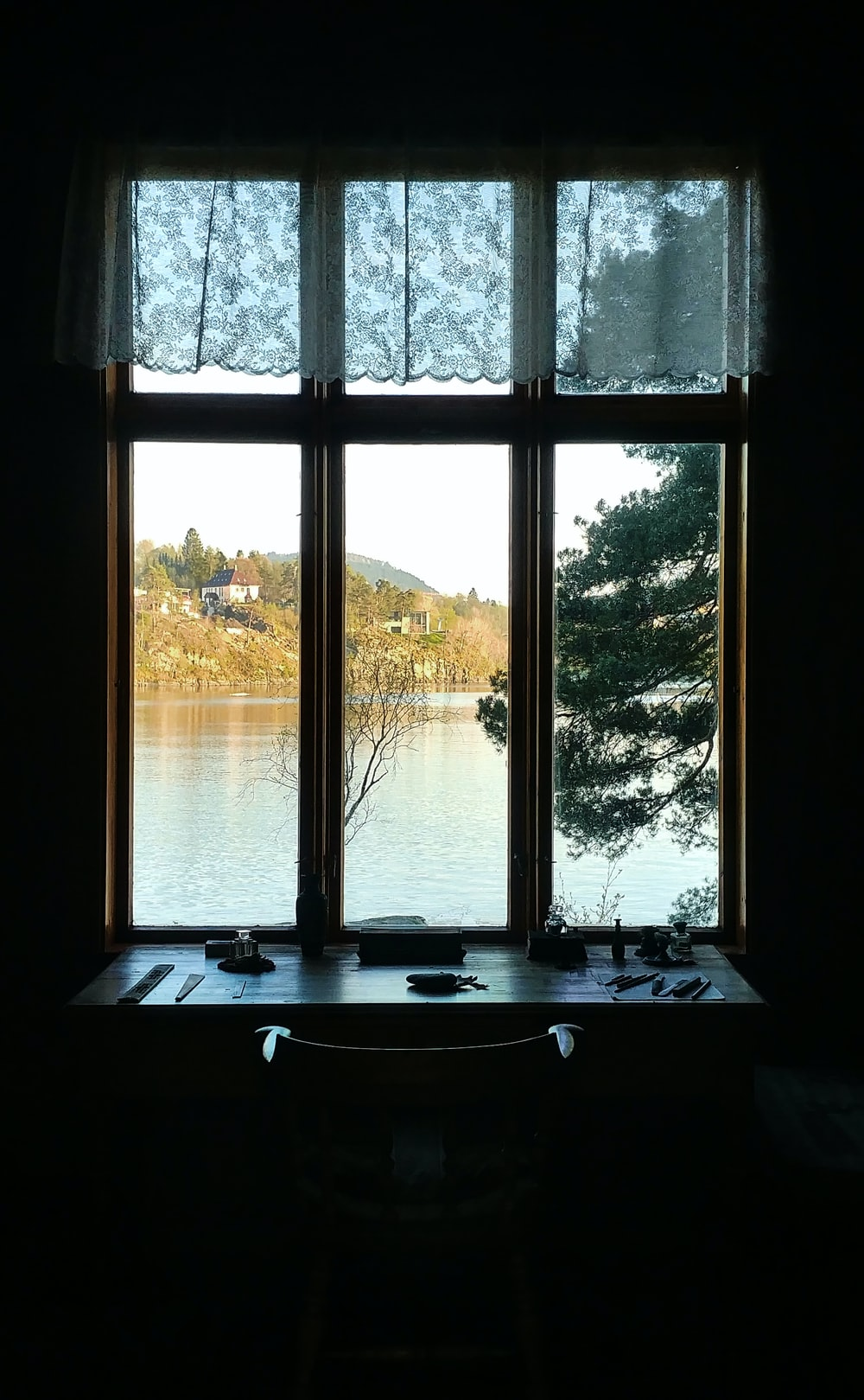 white wooden framed clear glass window
