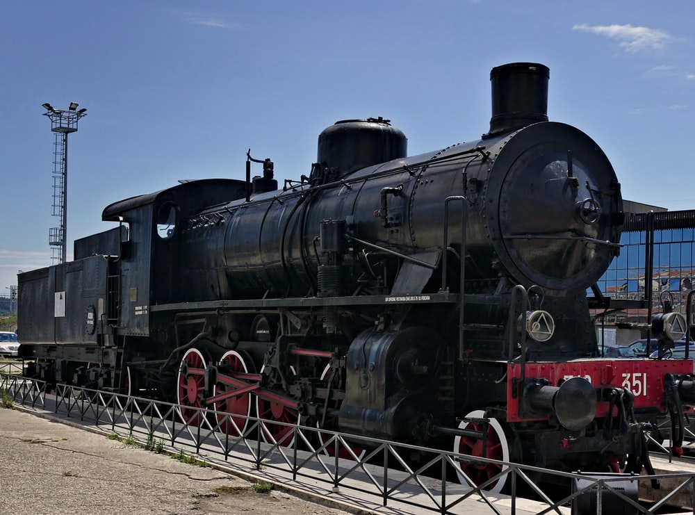 black train under blue skies