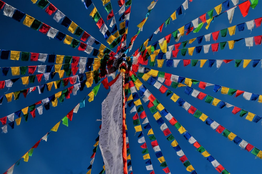 low-angle photography of multicolored pennant flags