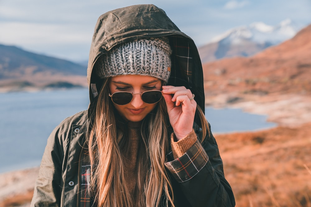 woman taking off her sunglasses