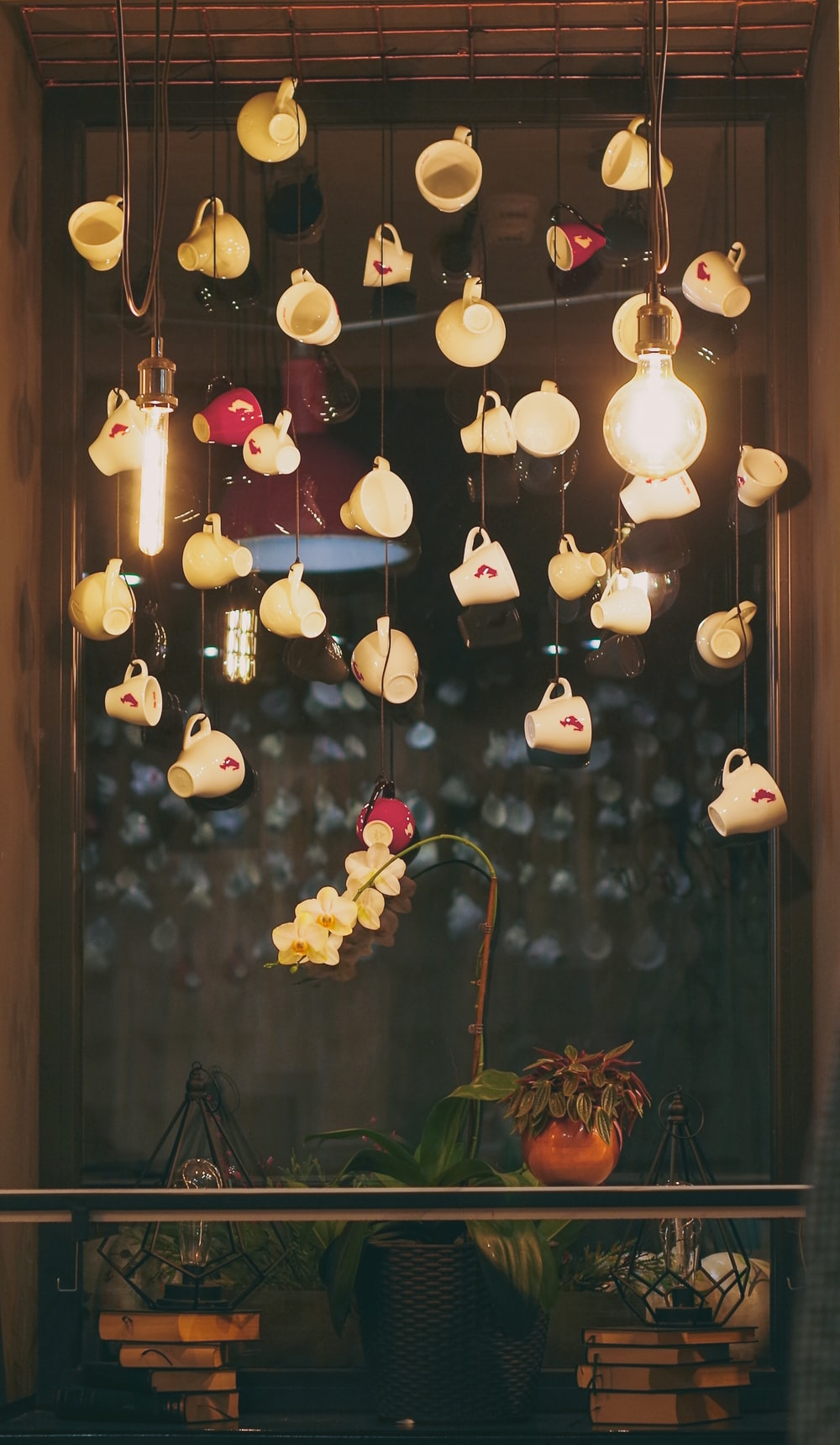 white ceramic teacups hanging from the ceiling