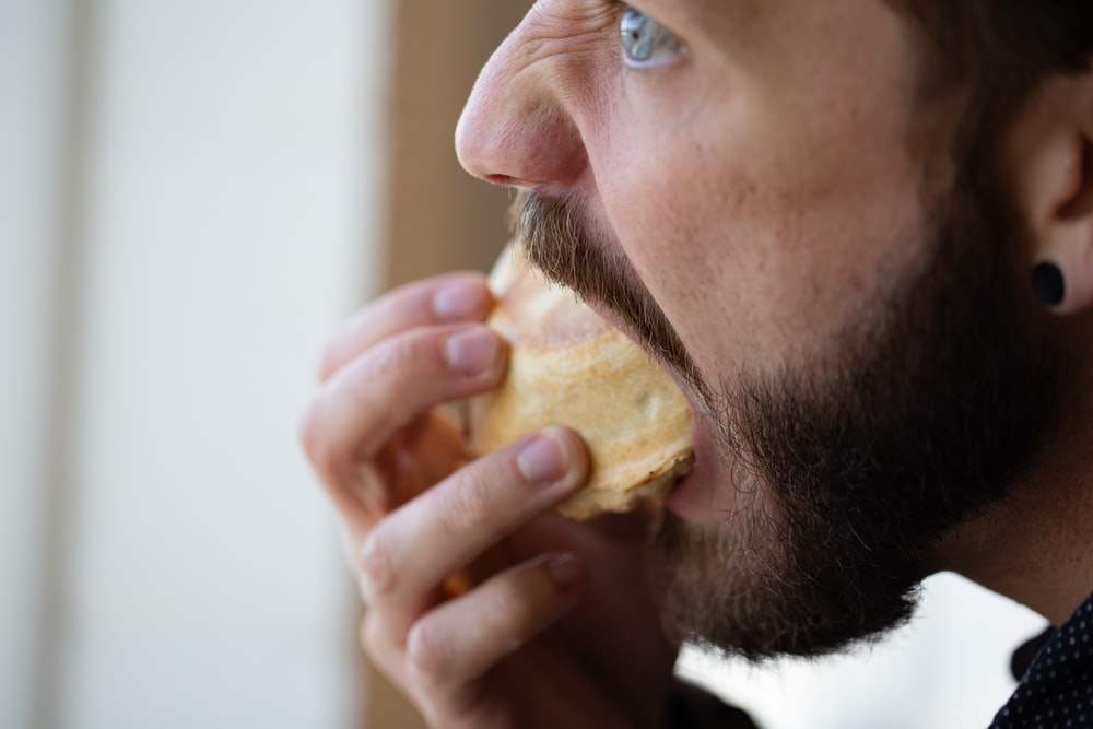 man eating muffin