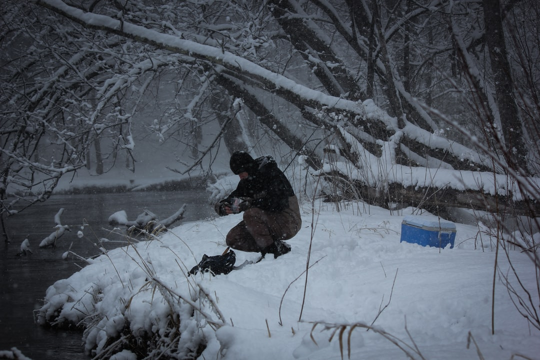 Fishing for Steelhead trout in Michigan's Pere Marquette River using waders to stand in the freezing waters. Taken April 5, 2018.
