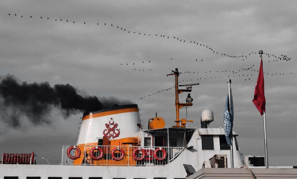 white ship under white sky