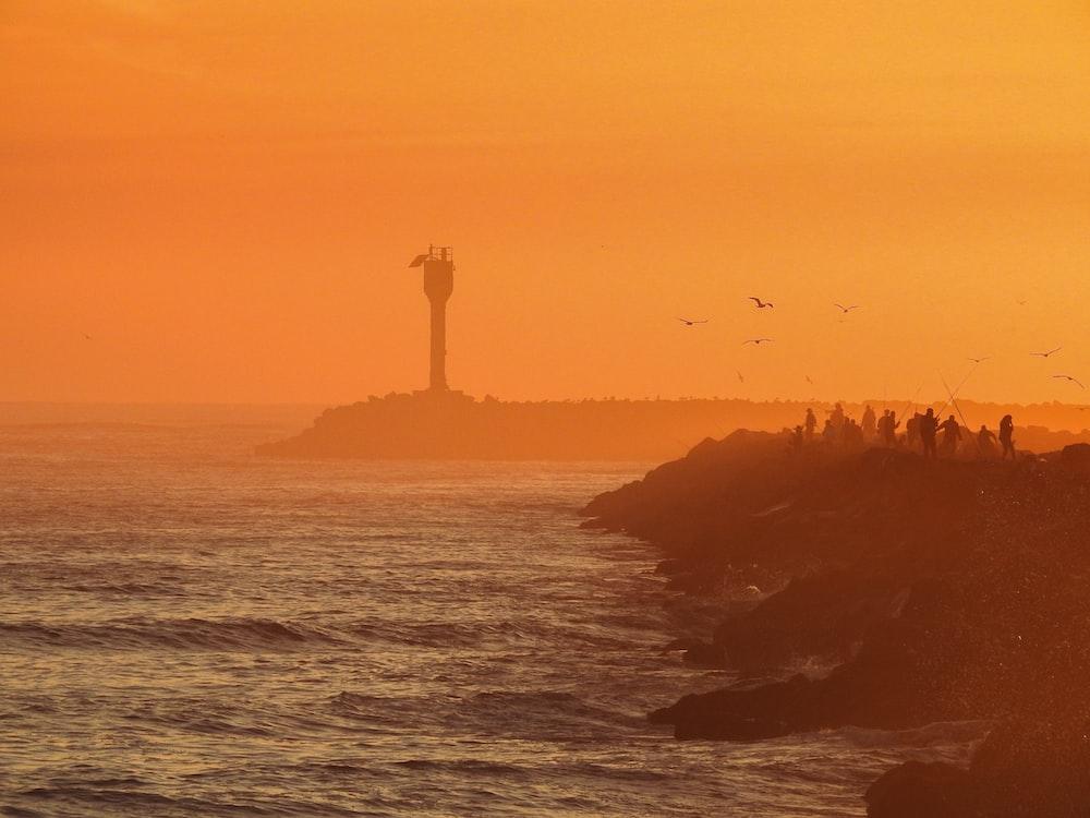 lighthouse facing ocean