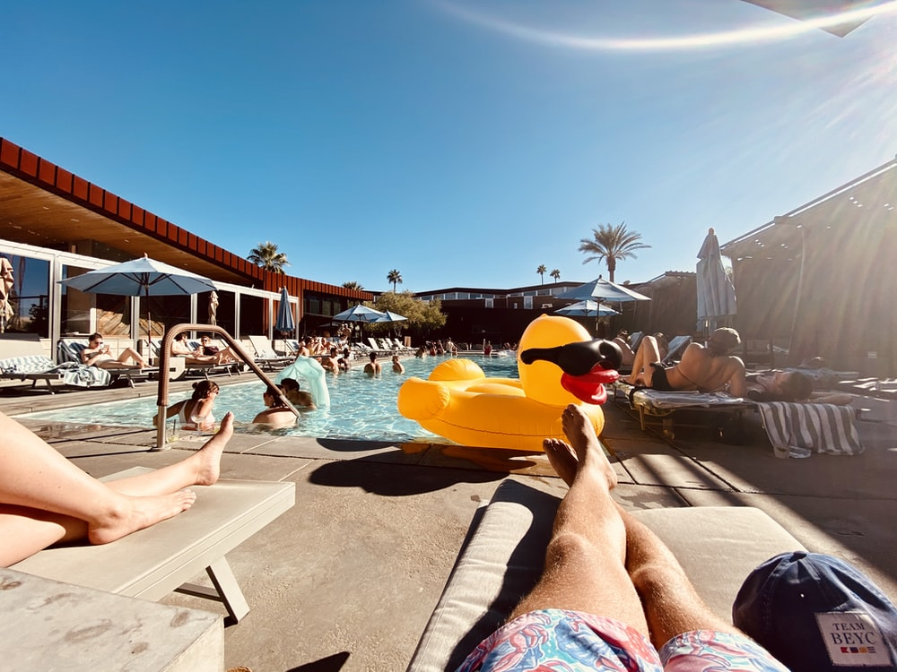 man and woman near pool