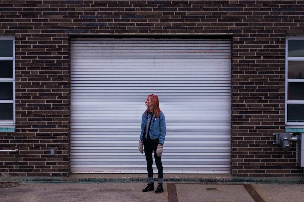 woman standing near roll-up door