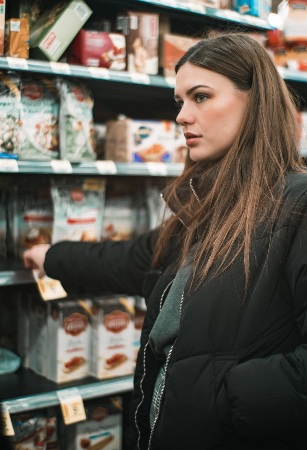 woman standing infront of shelf