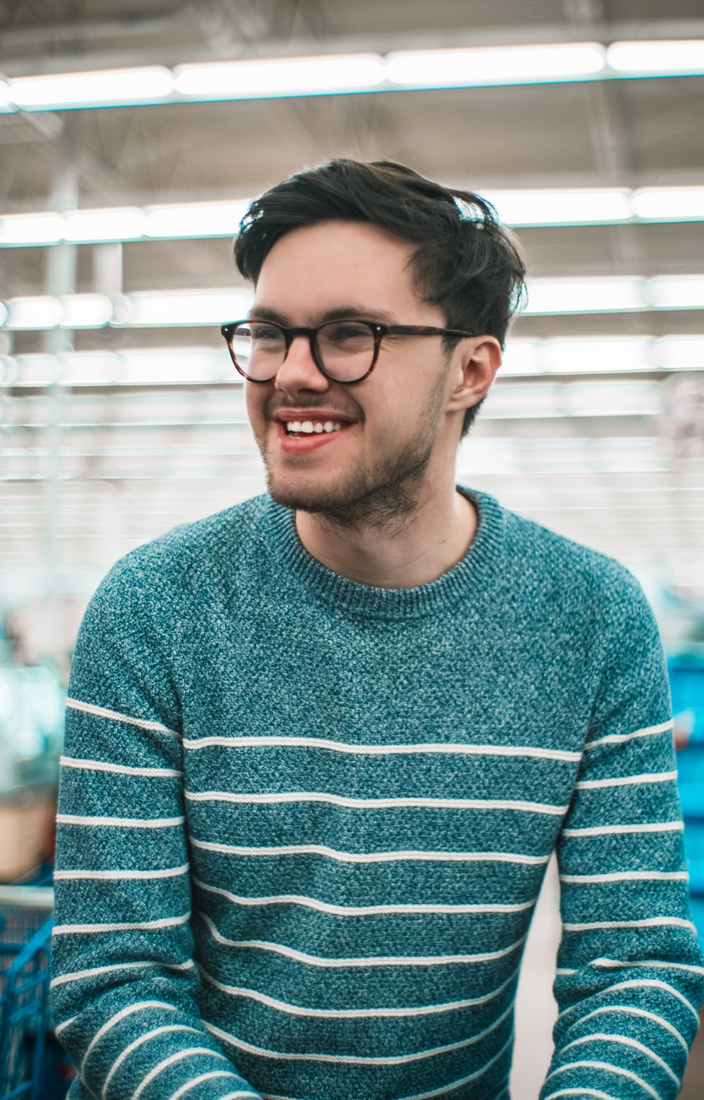 man wearing green and white striped long-sleeved sweatshirt