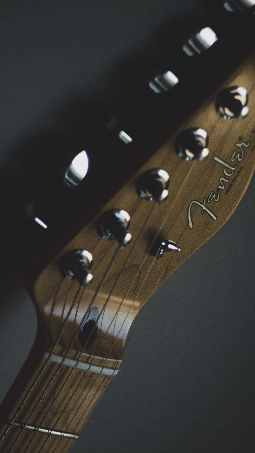 brown Fender guitar headstock