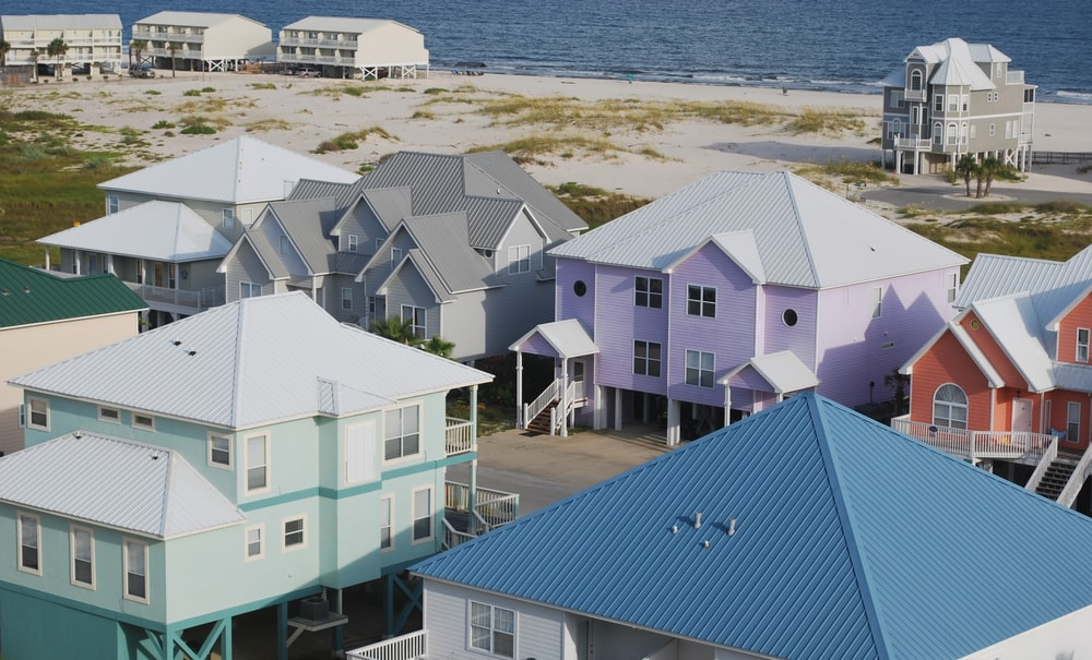 assorted-color houses near seashore