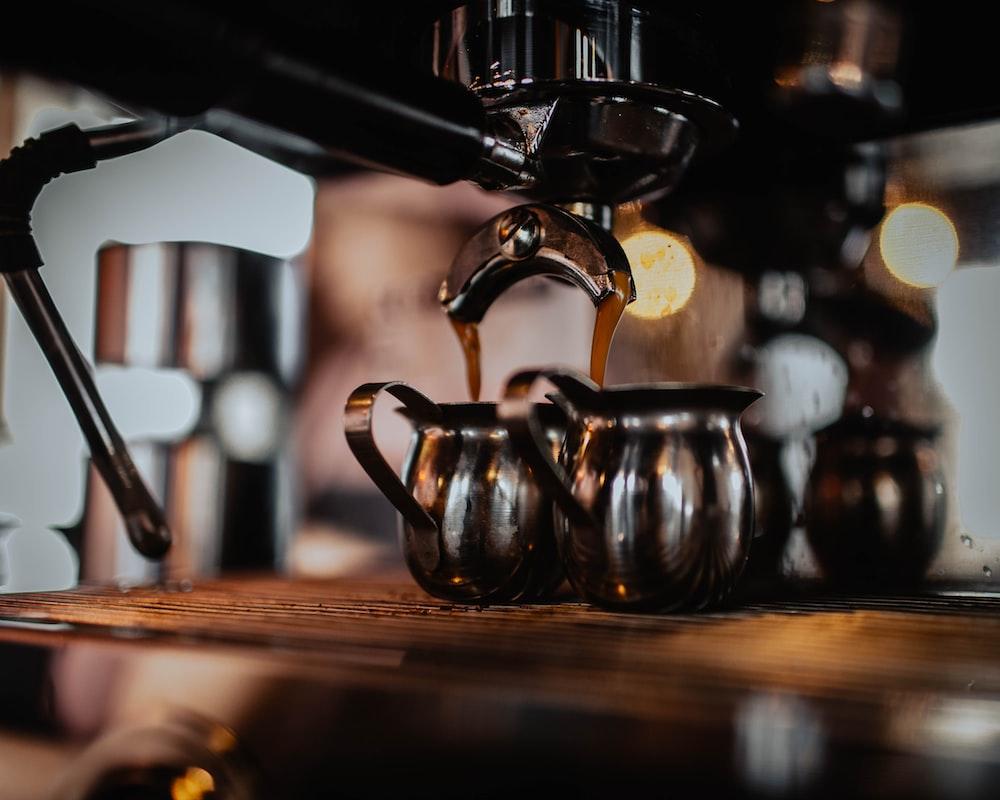 black coffee machine brewing coffee in kettle