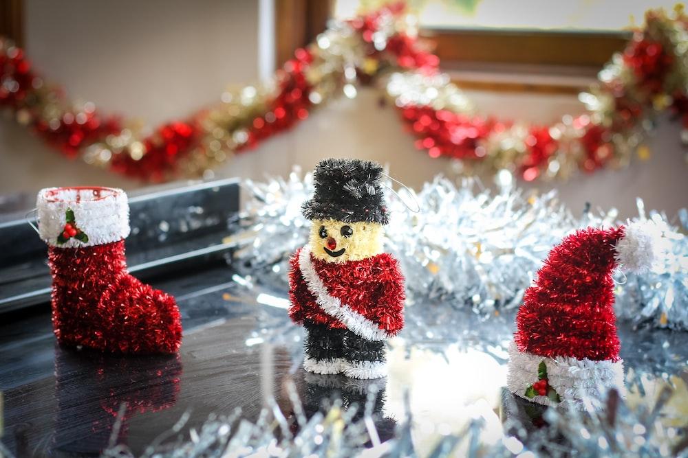 nutcracker ornament beside hat and sock