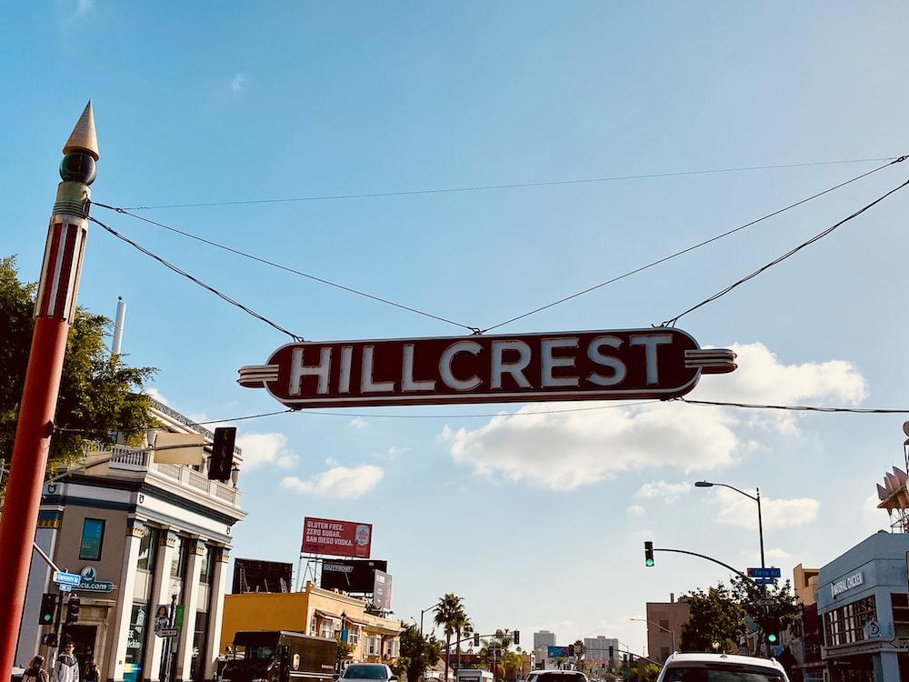 Hillcrest signage under blue cloudy sky